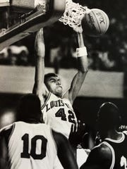 Pervis Ellison throws down a dunk vs. Southern Miss in 1987.