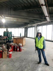 Kelly-Jane Cotter stands on the 88th floor of the new 1 World Trade Center during a visit with the 9/11 Tribute Center.