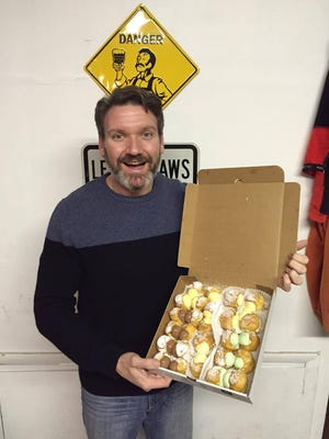 Cherry Hill man Kurt Fritzsche ate seven, cream-filled doughnuts in five minutes to advance to Wing Bowl 24