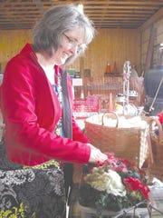 Julie Gordon picks through the hand dyed Romney fiber locks at 3L&S Farm booth. Gordon came from Columbia City, Indiana, to appreciate the Fiber Art Celebration.