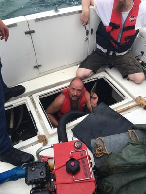 The Coast Guard and other responders rescued two people off Virginia Beach after their boat started taking on water Sunday, Aug. 7, 2016.