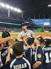 San Francisco Giants star Joe Panik greets the Poughkeepsie 10-and-under baseball team in Miami.