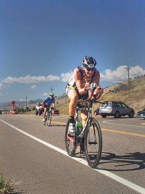 Lake Country Lutheran girls basketball coach and CEO of the city's Lutheran high schools, Cole Braun, is competing in a triple ironman this week.