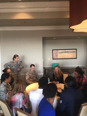 Montgomery Advertiser reporter Kym Klass, middle, talks to a group of airman from Maxwell Air Force Base in a roundtable discussion at the Women Empowering Women symposium at the Capitol City Club on Thursday, Nov. 3, in Montgomery.