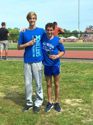 Medalists Spencer Estes, left, and Matt Grossman of the Millburn High School boys track team were scheduled to compete in the New Jersey State Interscholastic Athletic Association Meet of Champions June 8 at Central Regional High School in Bayville. Millburn's 4x800-meter boys relay team also was scheduled to run in yesterday's meet.