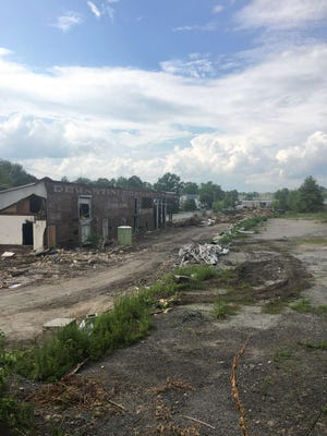 The former Demartini Coal and Lumber Co. on West Prospect Street laid to waste.