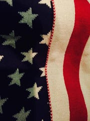 Alexandra Rucinski was given this American flag scarf after she gave a vendor the poster she carried during the Women's March on Washington on Saturday, Jan. 21, 2016.