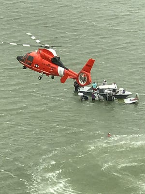Coast Guard helicopter crews responded to a capsized boat with four adults and two children and coordinated their rescue at the mouth of Baffin Bay Monday April 10, 2017..