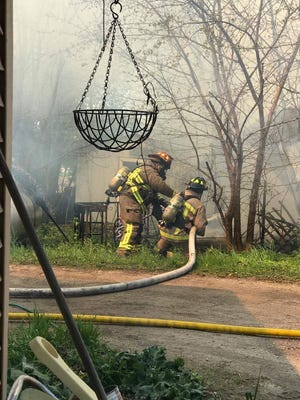 Firefighters fight off a garage fire in Ripon Sunday afternoon.