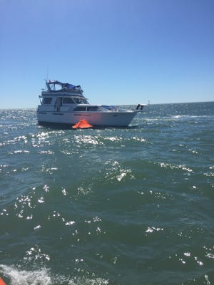 The Coast Guard rescued two boaters from a yacht on fire Friday, May 26.