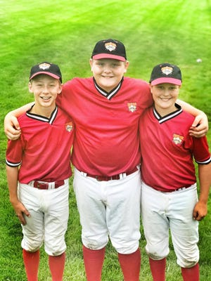 Fairview's Carter Durham, Dylan Hudson and Brady Mangrum all smiles at Cooperstown Dreams Park.