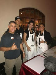 The crew of Black Tie Sushi Catering, owned by Daniel Chacon, pose at a recent event.