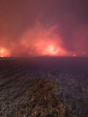 Fire fighters and ranchers battled a wildfire in 20