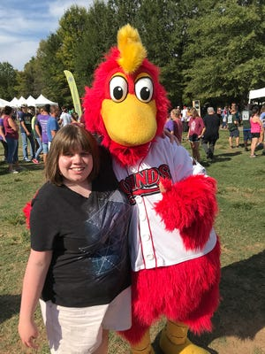 Mike Lawson want to make sure Fairview police have adequate training on interacting with autistic and mentally disabled children and adults like his daughter Kelly, shown here posing with Nashville Sounds mascot Ozzie.