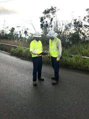 Mississippi Power engineer Matt Ball, left, discusses restoration work in Puerto Rico.