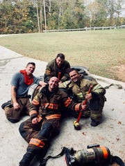 Reservoir firefighters, top from left, Capt. Bo Purvis, firefighter Mike Price and Lt. Carey McCluskey; and firefighter Adam Kitchens, front, fall out after practicing for the upcoming Brawn and Bubbles 5K for the Brain.