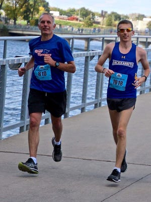 Jeff Janssen (left) and his son, Eric, ran in the IMT Des Moines Marathon in October. It was the 50th state that Jeff has run a marathon in. The Janssens are registered to run in the Lake Wobegon Trail Marathon on Saturday.