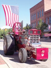 A tractor was displayed on Main Street during the morning activities at the 'Farm to Fork' event held in Union City, MI.