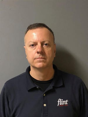 Gary W. Gagne,, of 50 Intrepid Lane, Jamestown was arrested by members of the Computer Crimes Unit at the Flint Audio-Video Middletown store . He was charged with:Soliciting another to commit a crime (access to a computer for fraudulent purposes)Conspiracy