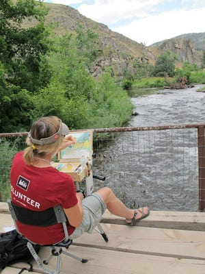 An artist captures the Poudre River at the 2013 Paint the Poudre Plein Air event.