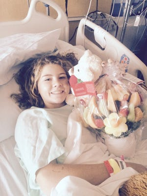 Though hospitalized, Rylee's spirits are still good, her mother, Donna, says.