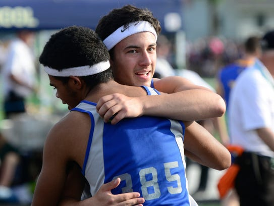 Wynford's Alizhah Watson, left, and Robbie Miller celebrate