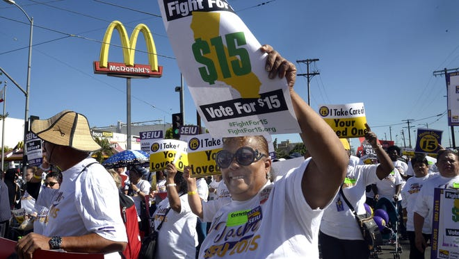Protests by fast food workers resulted in a rise in the minimum wage in a number of  states.