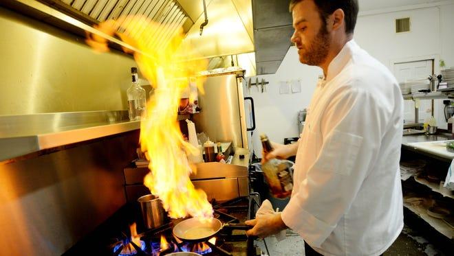 Aaron Atchison his kitchen at Janohn's.