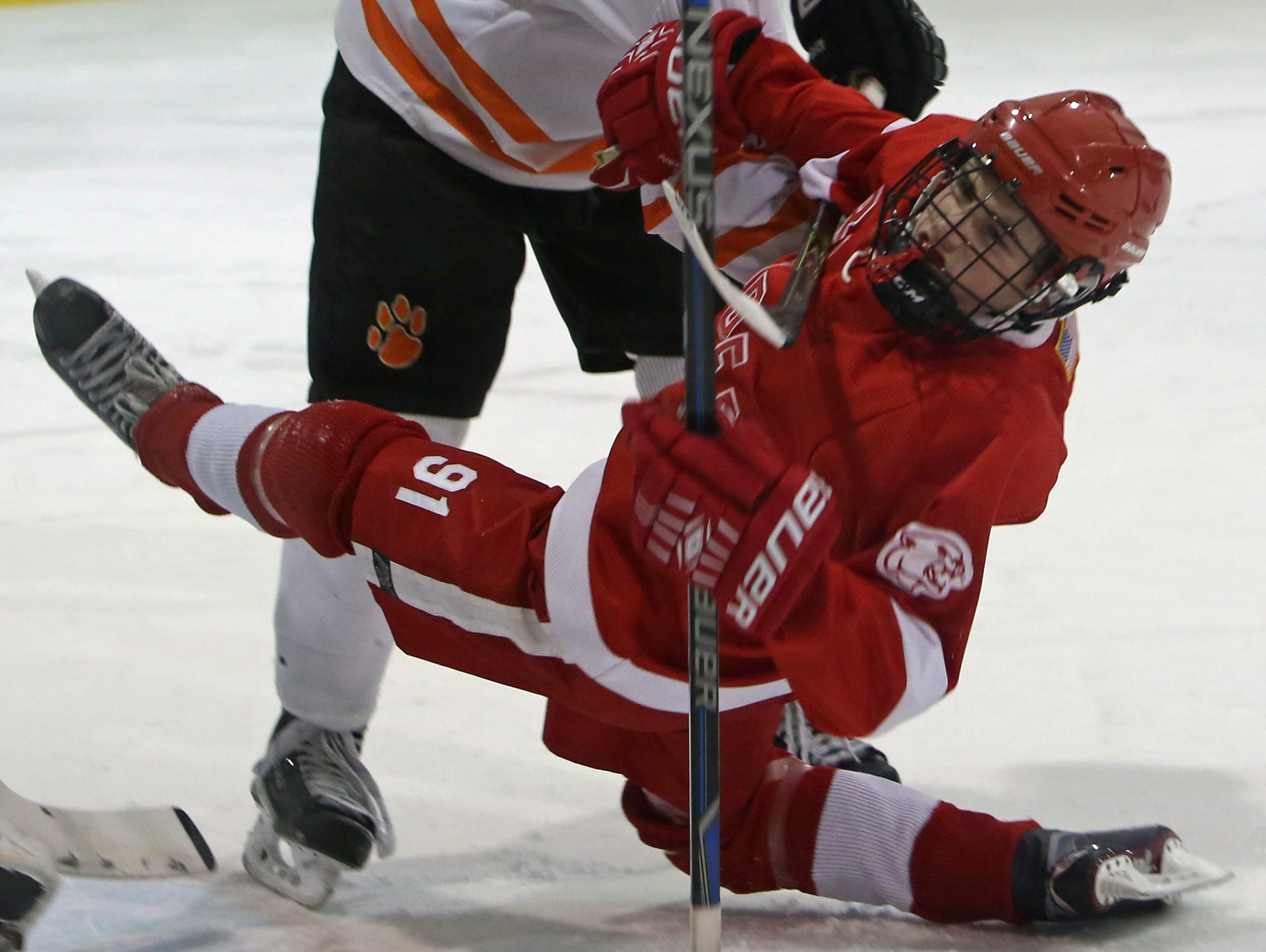 From left, White Plains' James Garnett (2) hits North Rockland's Christopher Hilliard (91) during hockey action at Ebersole Ice Rink in White Plains Jan. 7, 2016. The game ended in a 4-4 tie.