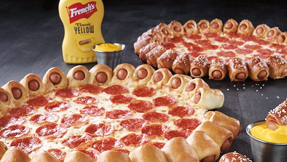 """How does 28 mini hot dogs wrapped in pizza crust sound? Yeah, we don't know how we feel about it either, but according to Pizza Hut, """"It's real."""""""