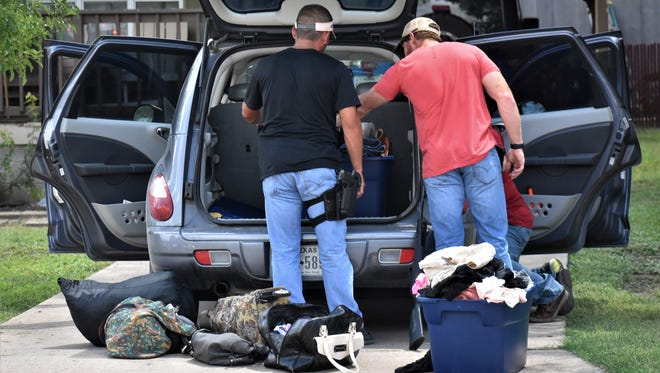 Police search Alonso Aredando's vehicle on July 12, 2018 following a short car chase.