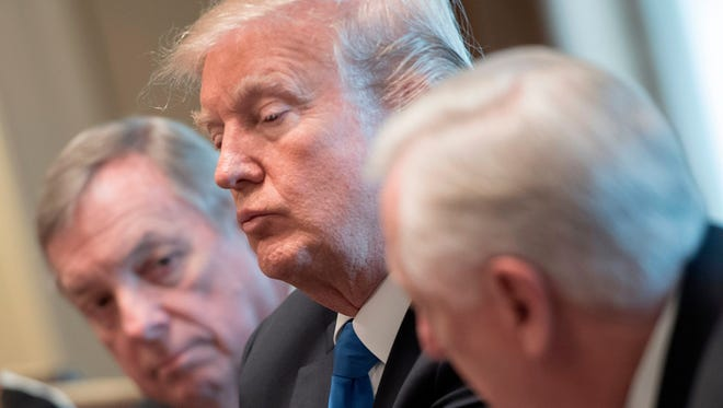 President Trump and Senator Dick Durbin, left, listen as Congressman Steny Hoyer speaks during a meeting with bipartisan members of the Senate on immigration at the White House in Washington, D.C., on Jan. 9, 2018.