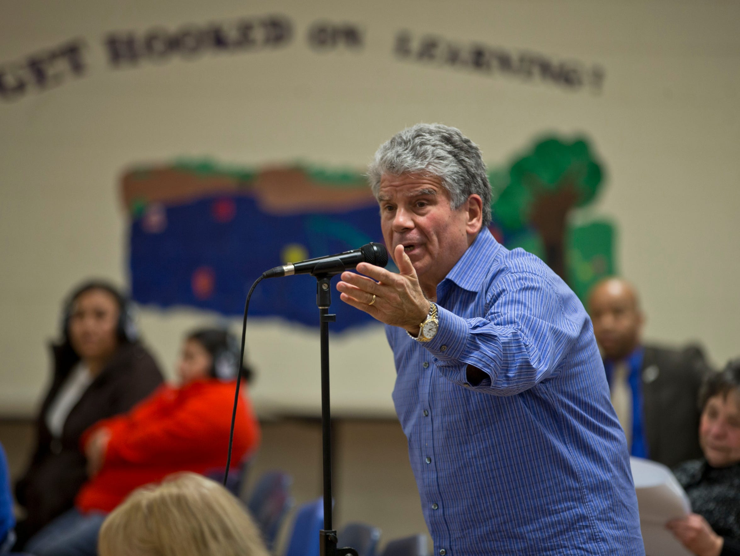 Tom Gatti speaks at a contentious meeting of the Lakewood