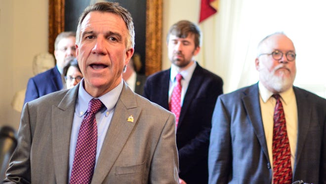 Gov. Phil Scott speaks to reporters in Montpelier on Wednesday, May 17, 2017.