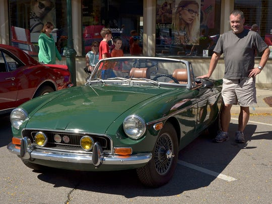 Glenn Newa, of Livonia, shows off his 1972 MGB coupe at the fall Festival car show.