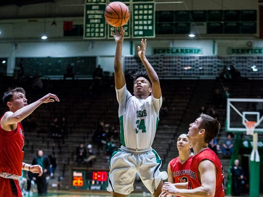 Yorktown's MiLon McCowan shoots past Blackford's defense during a sectional game at New Castle on Feb. 27, 2018.