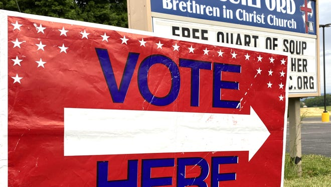 An election sign points toward the entrance of New Guilford Brethren in Christ Church in Chambersburg during Pennsylvania's primary election on Tuesday, June 2, 2020. JOHN IRWIN/ THE RECORD HERALD