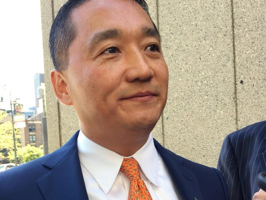 Wall Street exec  back to work after charges dropped