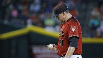 Arizona Diamondbacks relief pitcher Daniel Hudson (41) reacts after giving up a two run home-run to Toronto Blue Jays' Edwin Encarnacion (10) in the 8th inning of their MLB game Wednesday, July 20, 2016 in Phoenix,  Ariz..