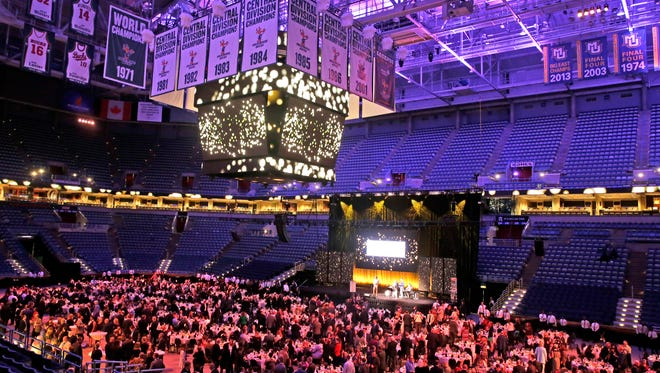 """The basketball floor at the Bradley Center serves as a banquet hall during """"Shine On,"""" a program to mark the end of the Bradley Center. The dinner and program raised money for a variety of local groups and honored Jane Bradley Pettit, a benefactor who provided the funding to build the 30-year-old structure."""