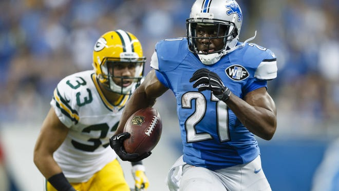 Lions running back Reggie Bush (21) breaks away from Packers free safety Micah Hyde (33) for a 26-yard rushing touchdown during the second half of an NFL football game in Detroit on Sept. 21.