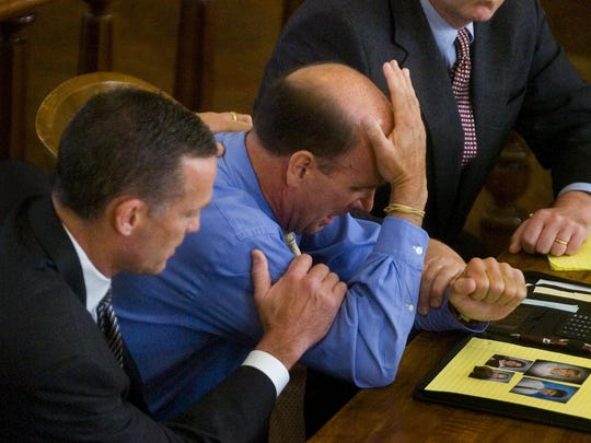 Defense attorneys comfort Calvin Harris as the jury come back with a guilty verdict in Tioga County Court in this 2007 file photo.