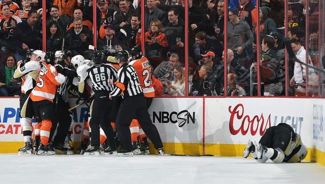 Kris Letang needed help getting off the ice after Rinaldo's boarding penalty in the waning moments of the second period.