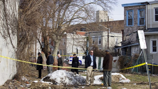 Authorities investigate at a home in the 500 block of Berkley Street in Camden after discovering two bodies in the backyard in 2010.