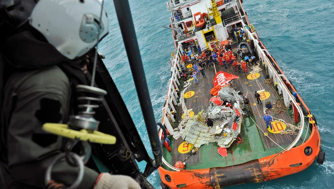 A portion of the tail of AirAsia Flight 8501 is seen on the deck of a rescue ship after it was recovered from the sea floor on the Java Sea on Jan. 10, 2015.
