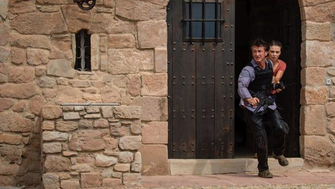 Jim (Sean Penn)  and Annie (Jasmine Trinca) come under fire in 'The Gunman.'