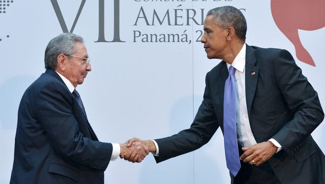 President Obama shakes hands with Cuban President Raul Castro in Panama City on April 11.