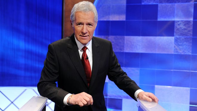 """Game show host Alex Trebek poses on the set of  """"Jeopardy!"""" on April 17, 2010. in Culver City, Calif."""