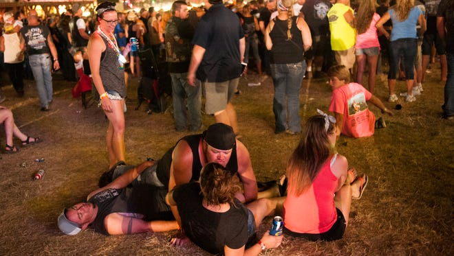 Revelers watch a concert at the Sturgis Buffalo Chip campground August 3, 2015 in Sturgis, South Dakota. This year marks the 75th anniversary of the Sturgis Motorcycle Rally, with crowds of up to 1.2 million people expected to visit.