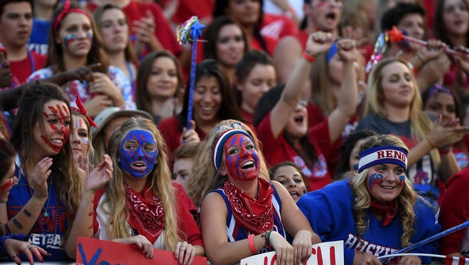Reno fans cheer while taking on Douglas during their football game in Reno on Friday, Sept. 11, 2015.